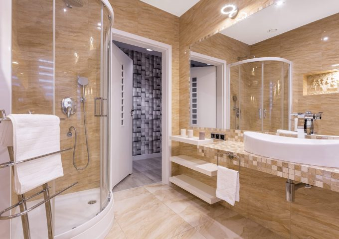 Modern shower with glass door in up-to-date stylish bathroom